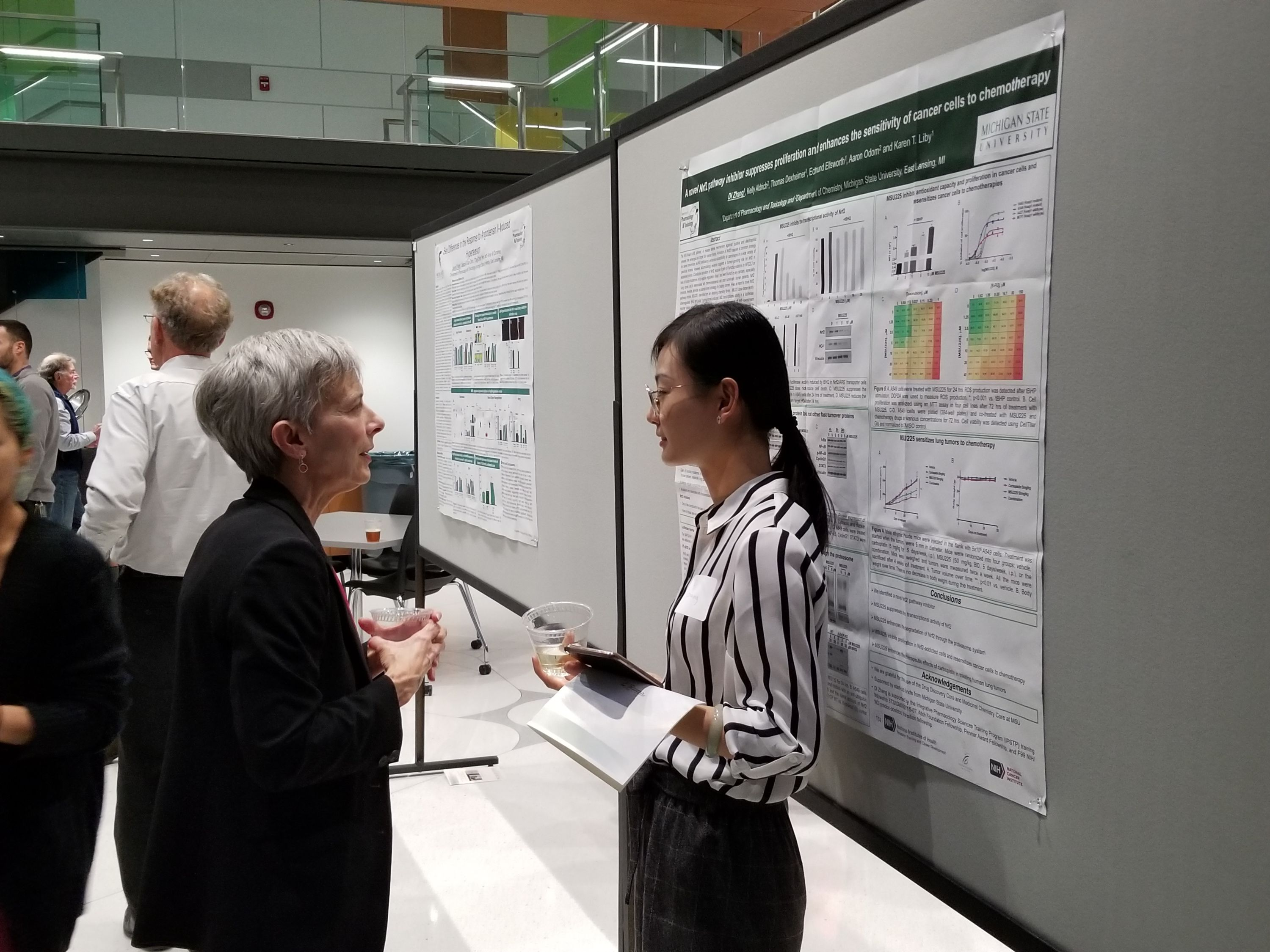Photo of PharmTox Faculty & Students presenting posters